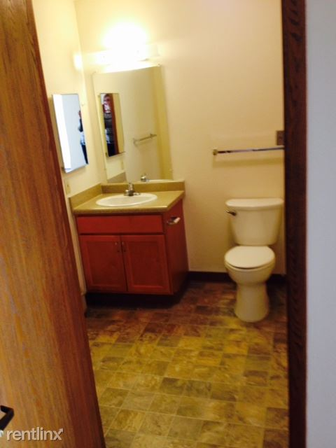 Spacious Bathroom with pull cord & grab bars