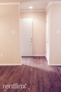 Entry (easy-care wood-look plank flooring, crown-molding)