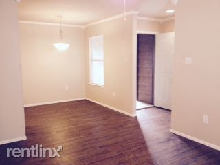 Dining Room, Entry, crown-molding, easy-care wood-look plank flooring