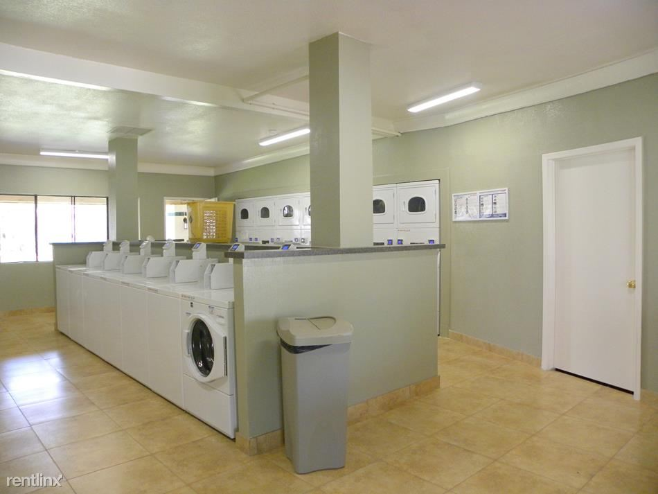 On-Site Laundry Facility with Machines that Accept Credit/Debit, Coins, and Cash