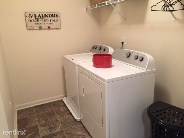 Laundry Room with Full size Washer Dryer