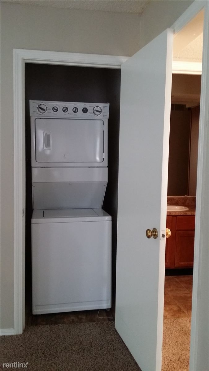 laundry room stackable washer dryer provided