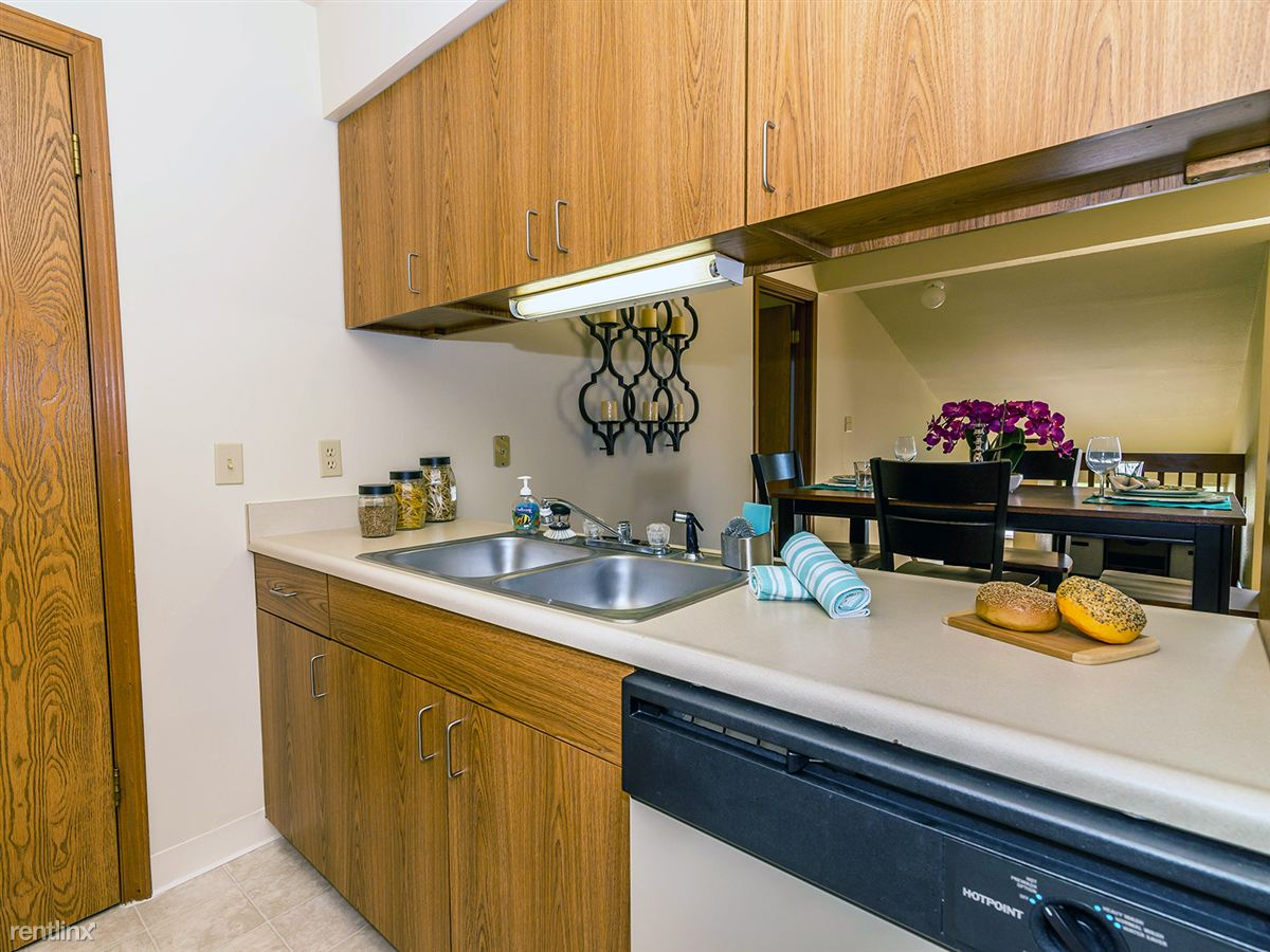 Kitchens come decked out with plenty of cabinet space, and even include a dishwasher!