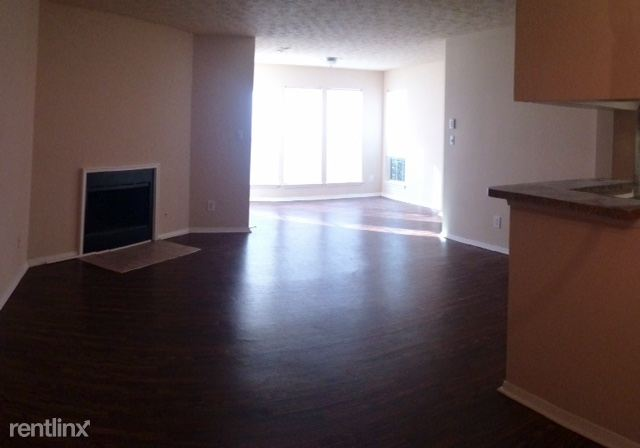Vacant Apartment; View is from dining room looking into the living room & sun room.