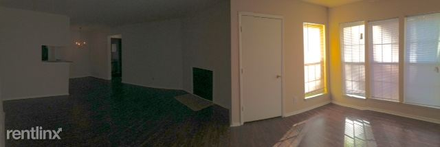 Vacant Apartment; View is from sunroom looking into the living room & dining room.