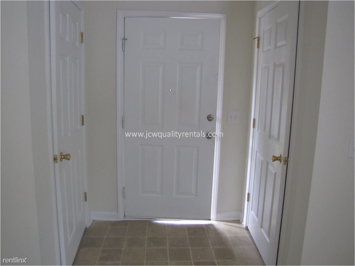 Entry door with two coat closets