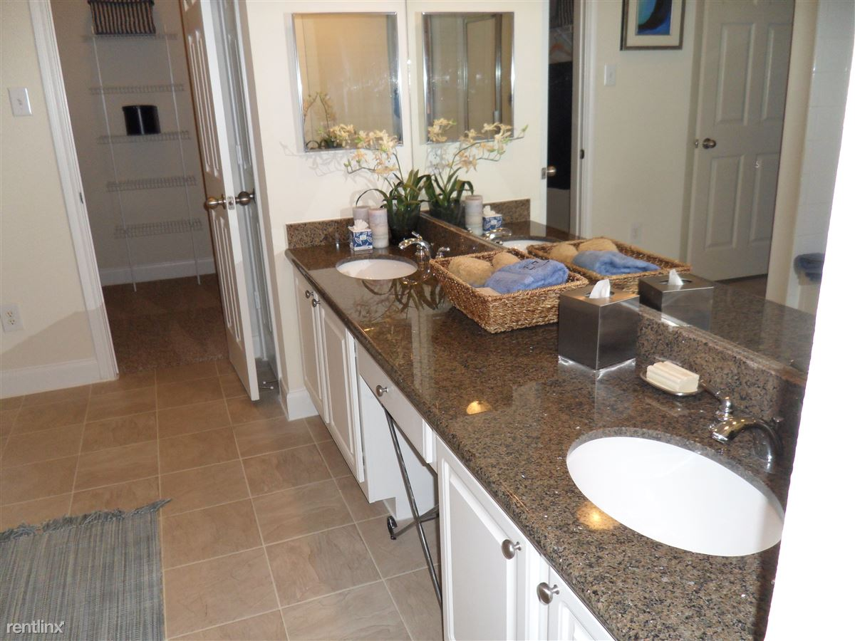 Dual sinks with a vanity area. Perfect for morning time rushing, or relaxing time!