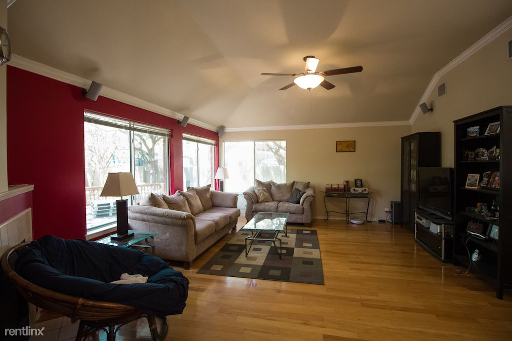 Living room with large windows to backyard and wired for surround sound