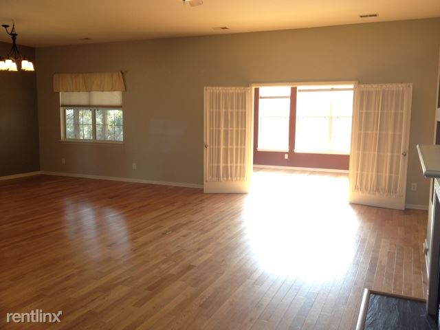 Living Room into Sunroom with Dining Area on left