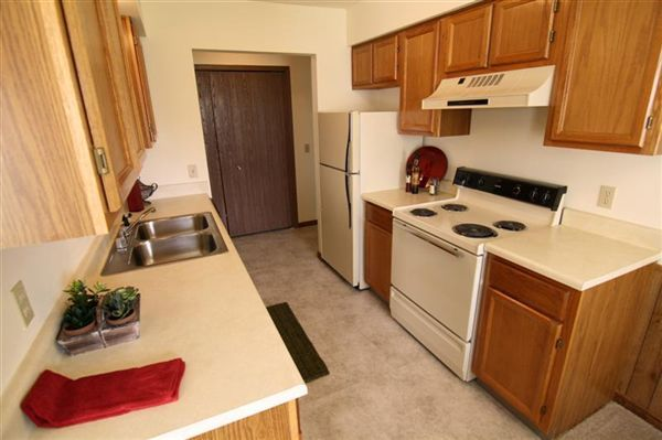 Kitchen with range, refrigerator and dishwasher