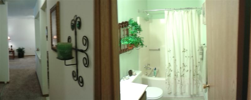 Panoramic View of the Hallway leading into the Bathroom
