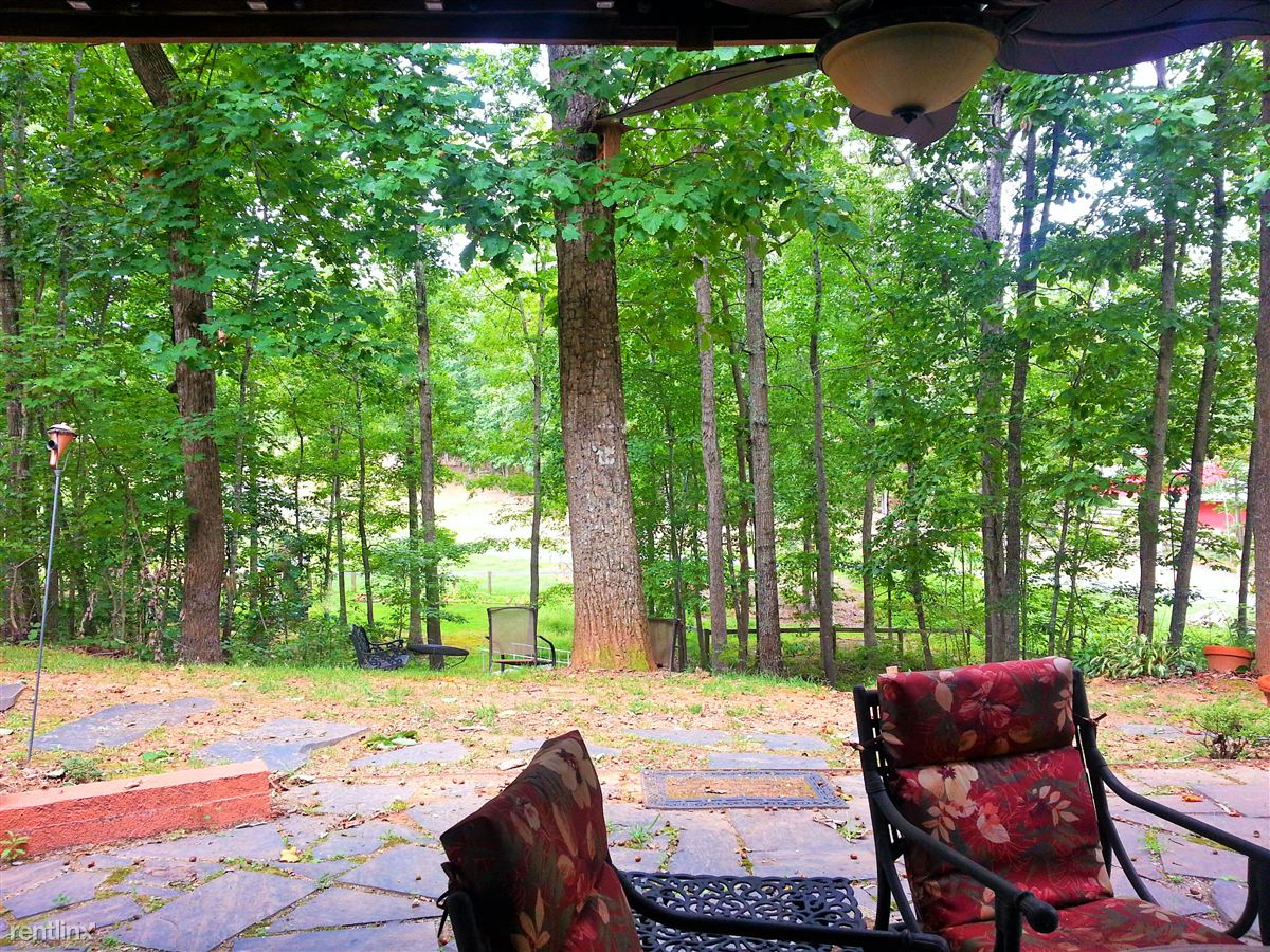 Large patio off Master suite with ceiling fan and patio furnitur