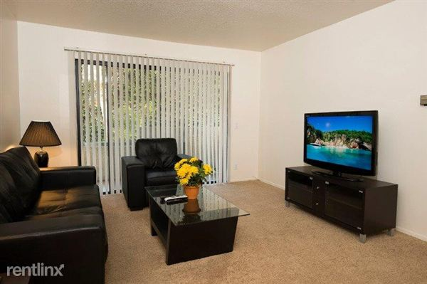 "Living Room with 42"" LCD HDTV with Roku TV"