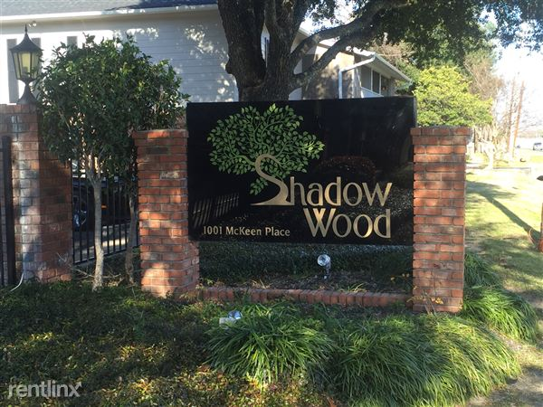 Shadow Wood sign located directly in front of the leasing office.