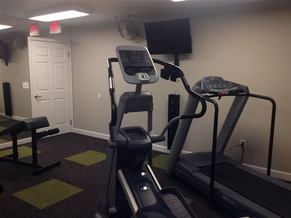 24/7 fitness center and yoga room