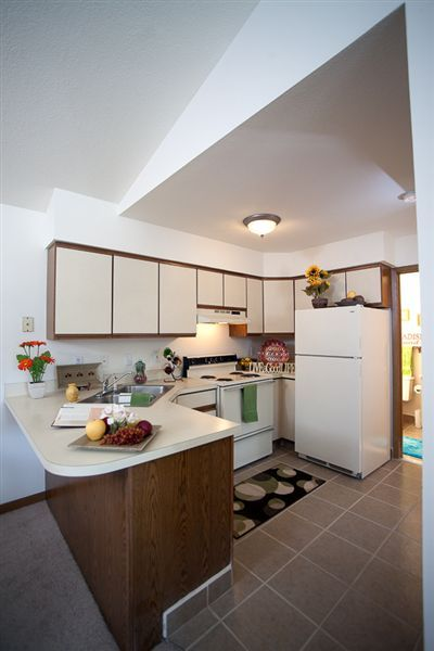 Open kitchen with breakfast bar in 1 & 2 BR Ranch Series