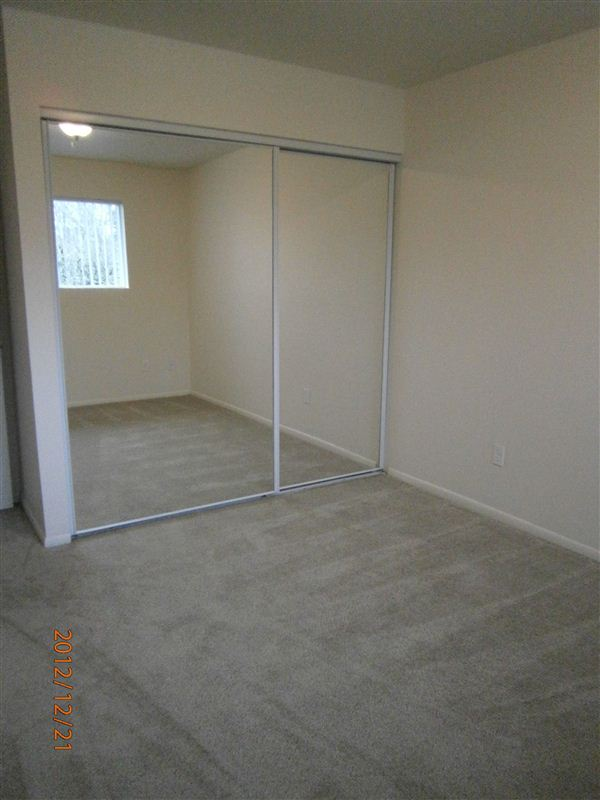 Master Bedroom with new sliding mirror closet doors, window, lighting, and flooring
